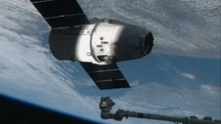 SpaceXs Dragon Capsule is seen on the end of the International Space Stations robotic arm on Sunday, March 3, 2013.