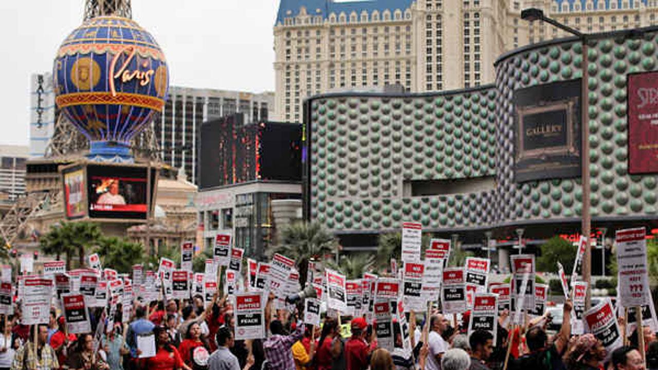 Culinary Union workers demonstrate along Las Vegas Boulevard outside the Cosmopolitan Hotel and Casino while protesting their contract negotiations with Deutsche Bank, Wednesday, March 20, 2013, in Las Vegas.