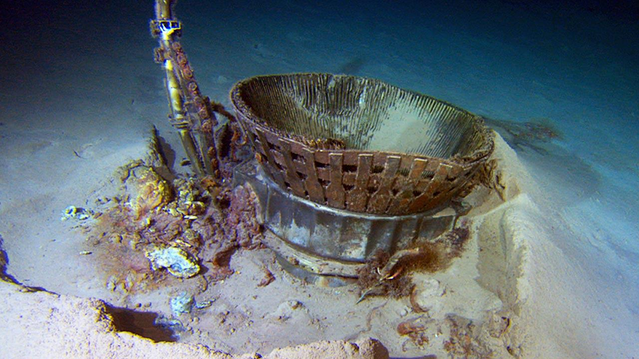 This image provided by Bezos Expeditions shows a thrust chamber of an Apollo F-1 engine on the bottom of the Atlantic Ocean in March 2013.