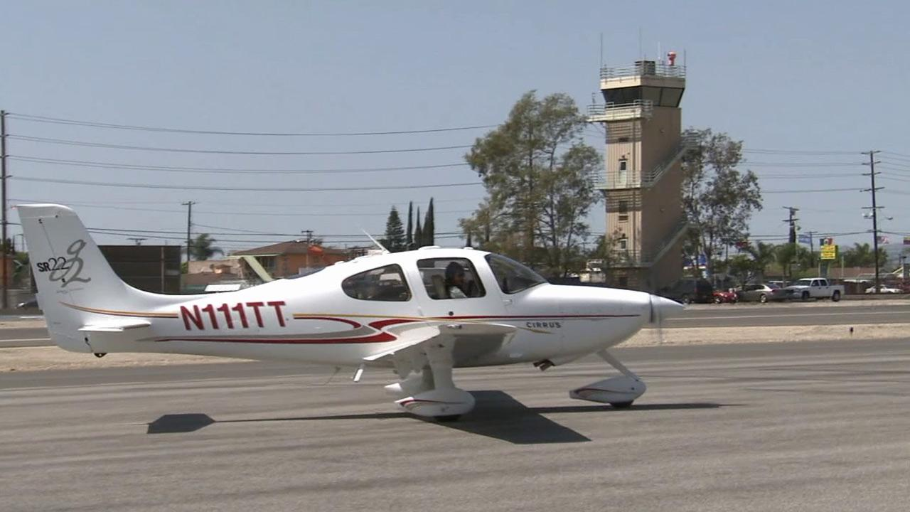 Thomas Close, a retired United Airlines pilot, has a perfect landing at the Whiteman Airport in Pacoima Friday, March 22, 2013.