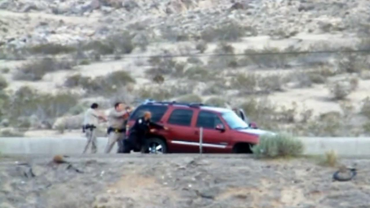 Authorities surround the SUV of former Nevada Assemblyman Steven Brooks after a pursuit on Thursday, March 28, 2013.