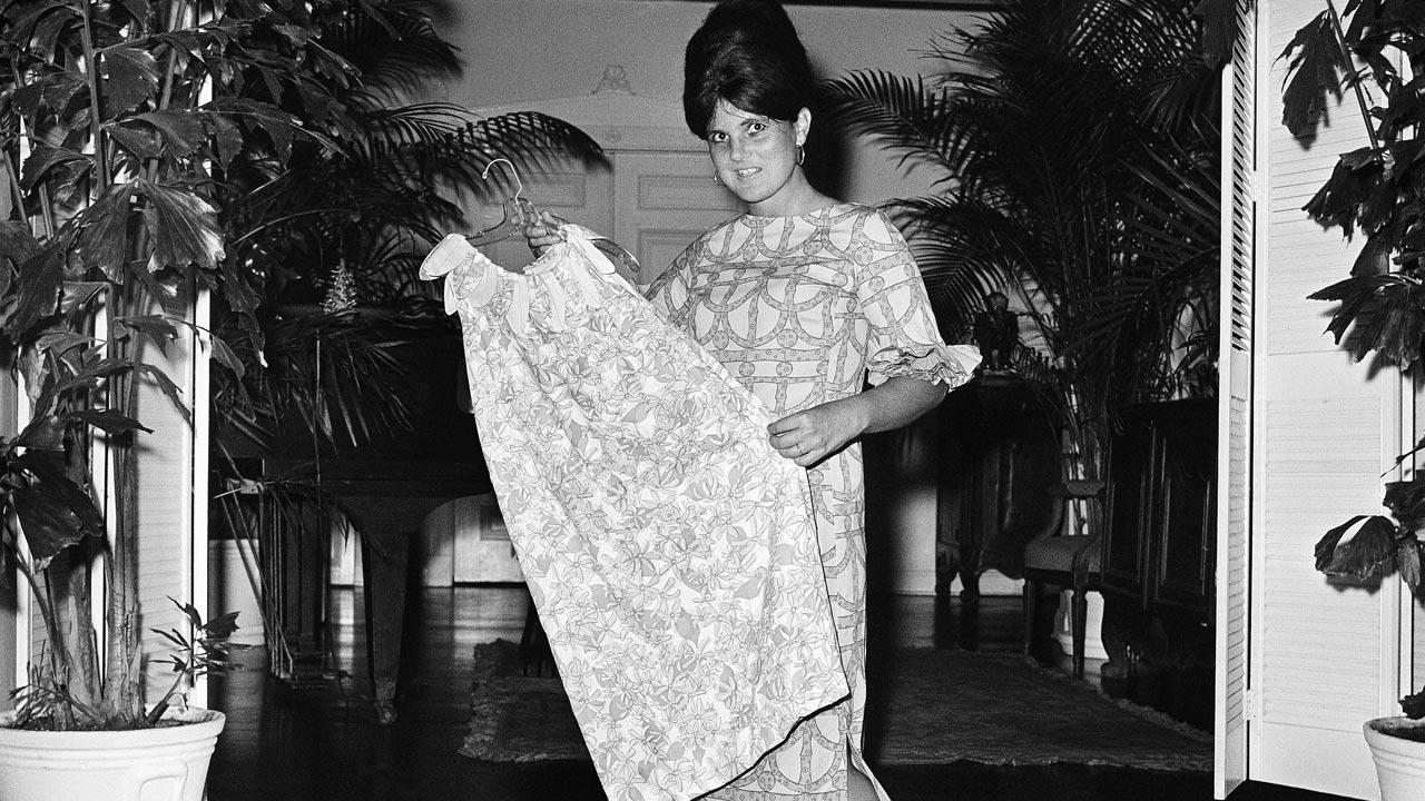Fashion designer Lilly Pulitzer poses with her own design and creation, the Lilly shift, in this March 16, 1965 file photo. Pulitzer died Sunday, April 7, 2013 in Palm Beach. She was 81.Robert H. Houston, File