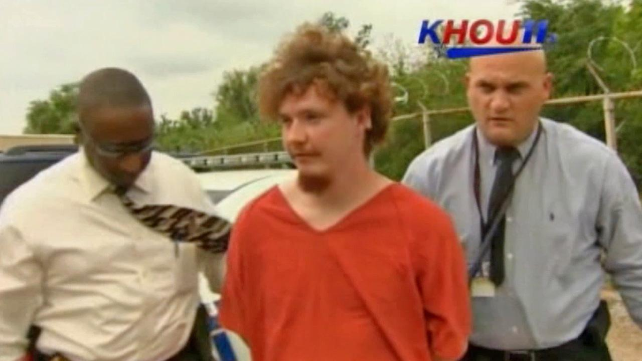 A man accused of a violent attack at Lone Star College in Texas is taken into custody on Tuesday, April 9, 2013.