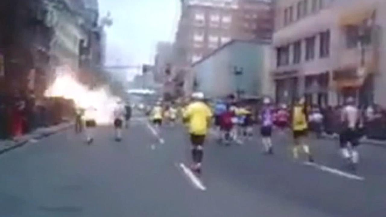 This still from a video taken by marathon runner Jennifer Treacy shows a bomb going off near the finish line at the Boston Marathon on Monday, April 15, 2013. <span class=meta>(Courtesy of Jennifer Treacy)</span>