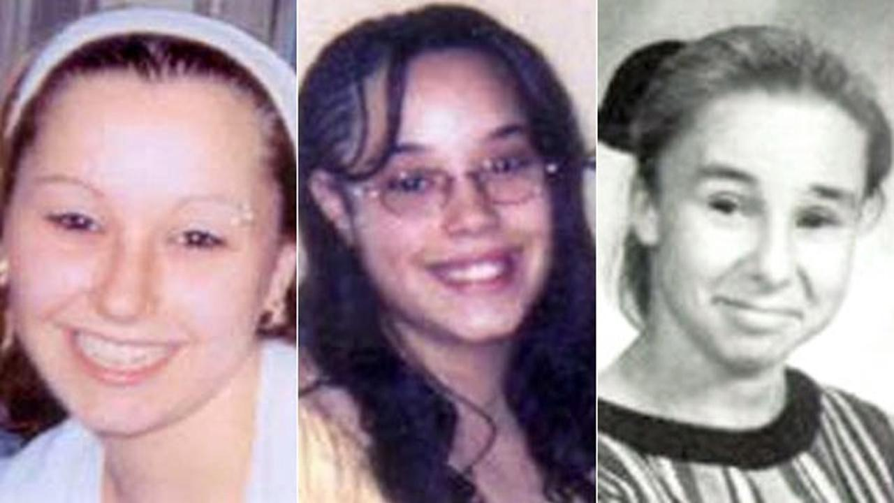 Undated handout photos provided by the FBI show Amanda Berry, left, and Georgina Gina Dejesus, center. Michelle Knights 1998 freshman year high school picture, right, at James Ford Rhodes High School in Cleveland, Ohio.