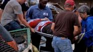 A survivor is carried out of the damage area after a deadly tornado hit Moore, Okla., Monday, May 20, 2013.