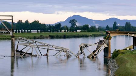 A collapsed portion of the Interstate 5 bridge lies in the Skagit River Friday, May 24, 2013, in Mount Vernon, Wash.