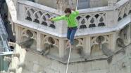 A man makes the first tightrope walk between the two towers of St. Stephens Cathedral in Austria.