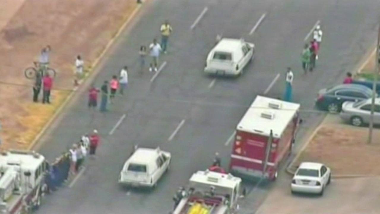 A caravan of hearses carrying the bodies of 19 firefighters killed in the Yarnell, Ariz., wildfire travels through Arizona as people stop to pay their respects Sunday, July 7, 2013.