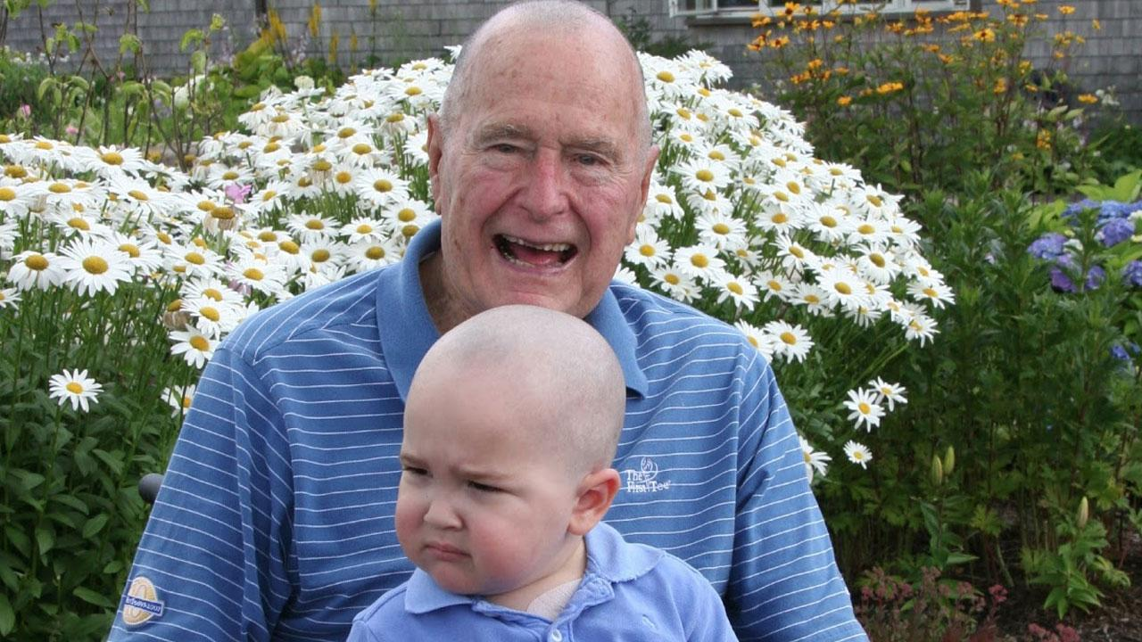Former President George H.W. Bush poses with young cancer patient Patrick in this undated photo.
