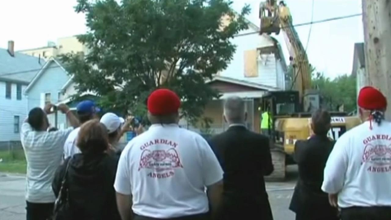 Ariel Castros Cleveland house is torn down Wednesday, Aug. 7, 2013. Gina DeJesus, Michelle Knight and Amanda Berry were held captive and raped at the house for over a decade before escaping May 6.