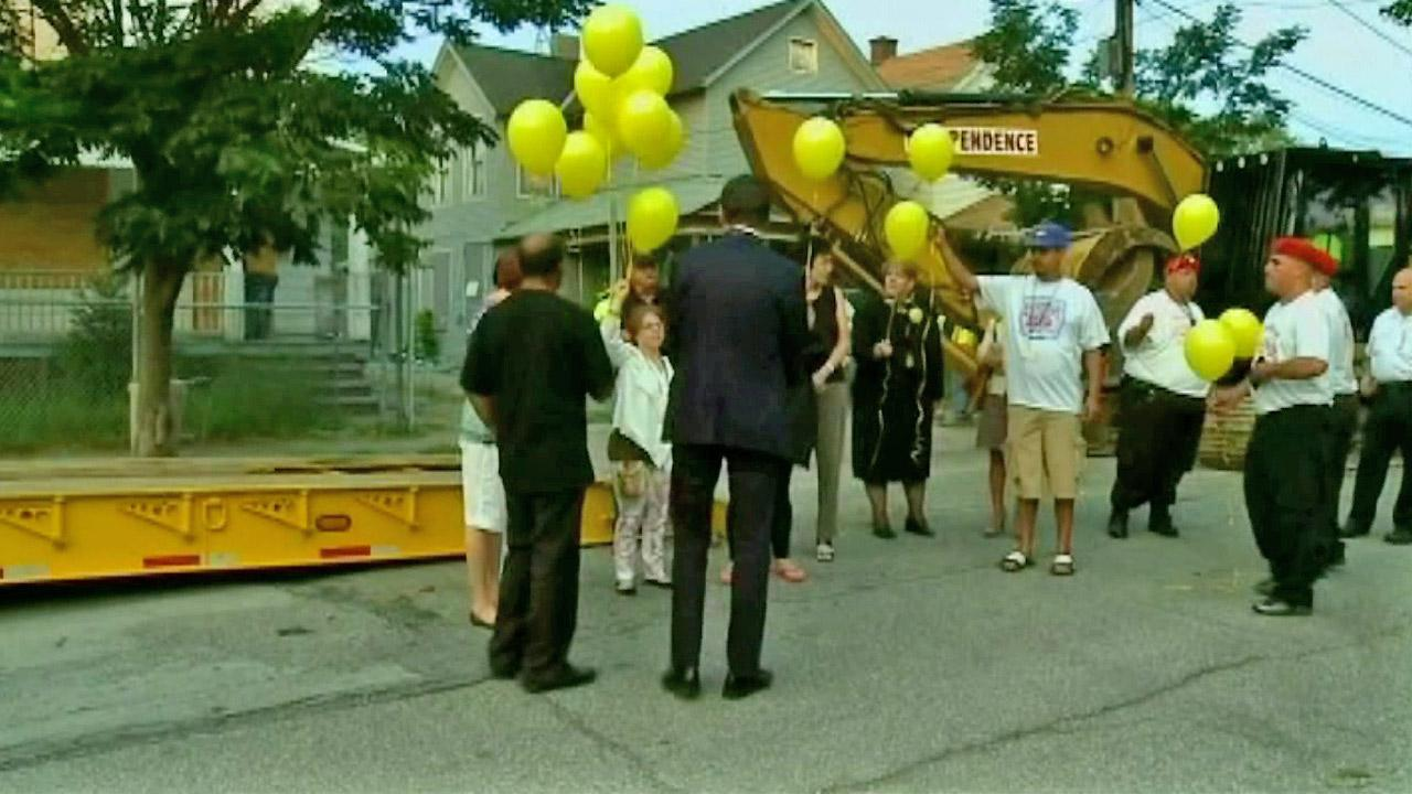 Michelle Knight, one of three women held captive in Ariel Castros Cleveland house, gathers with a crowd of people to release balloons before the house is torn down Wednesday, Aug. 7, 2013.