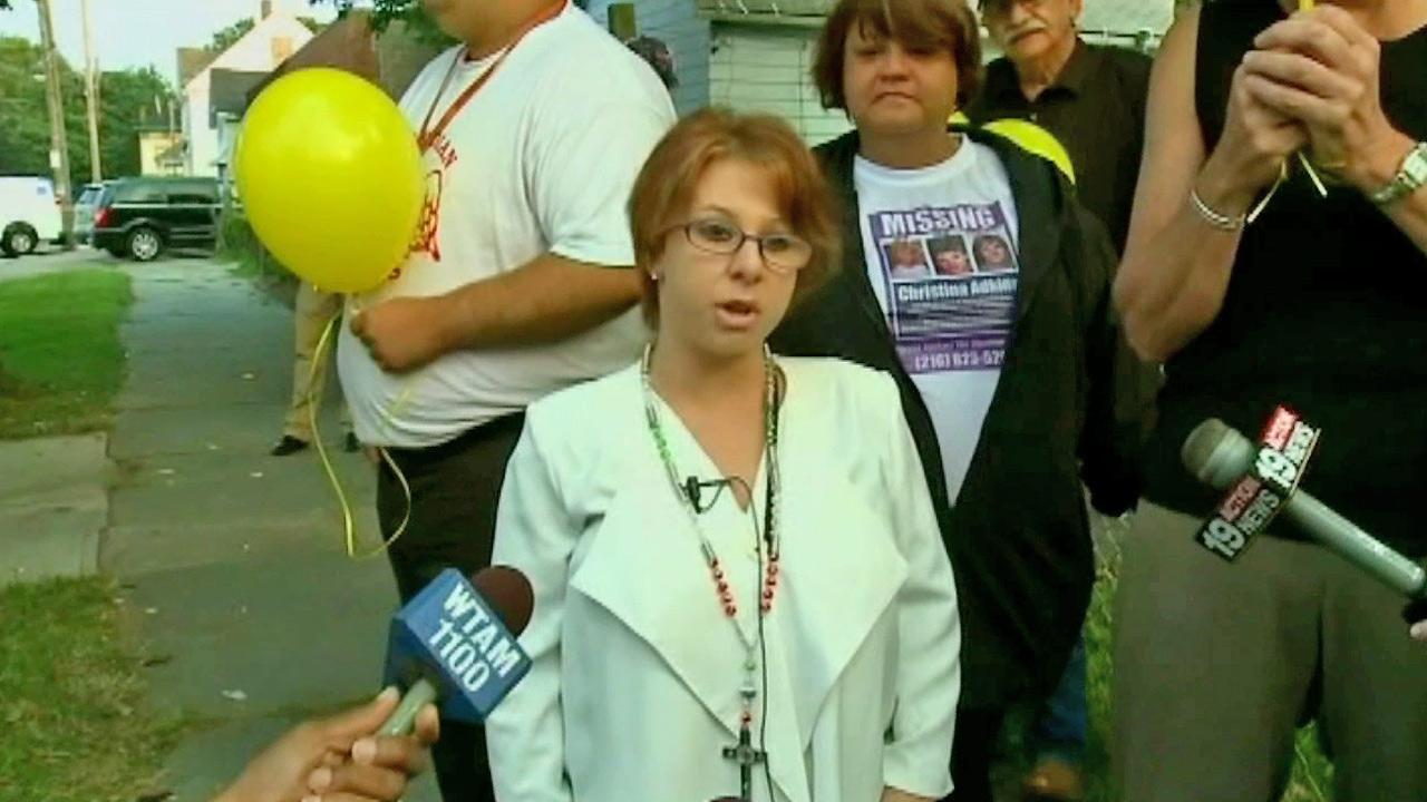 Michelle Knight, one of three women held captive in Ariel Castros Cleveland house, speaks before the house is torn down Wednesday, Aug. 7, 2013.
