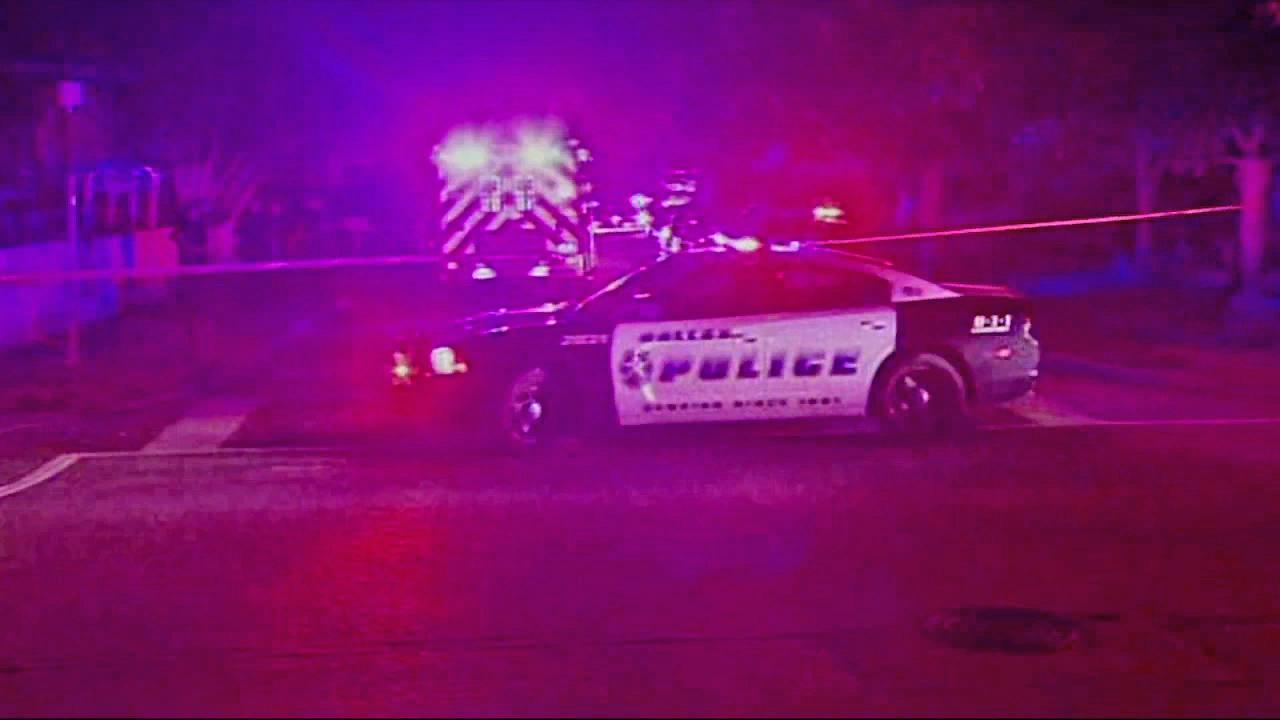 Police are seen at one of two Dallas-area shooting scenes. The shootings left four people dead and four others wounded  Wednesday, Aug. 7, 2013.