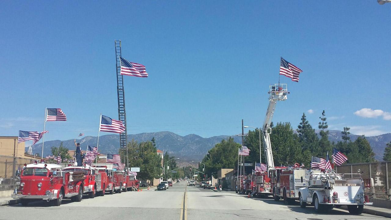 Flags are put on display at the San Gorgonio overpass and the 10 Freeway in Banning for the 12th anniversary of the Sept. 11 terrorist attacks. <span class=meta>(Troy Case)</span>
