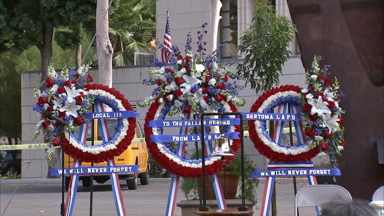 Standing before a steel girder from the World Trade Center, Los Angeles officials marked the anniversary of the 9/11 terror attacks with speeches, a bell ringing ceremony and a rendition of Taps on Wednesday, Sept. 11, 2013.