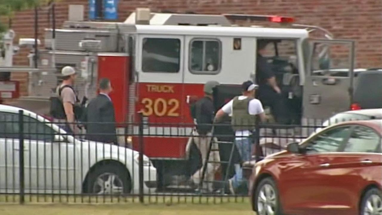 Authorities on-scene of a shooting at the Washington D.C. Navy Yard on Monday, Sept. 16, 2013.