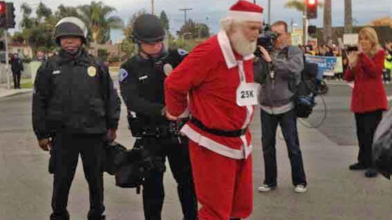 Ten people, including a man dressed as Santa Claus, were arrested for failure to disperse at a protest held in front of a Wal-Mart store on the 1300 block of Mountain Avenue in Ontario Friday, Nov. 29, 2013.