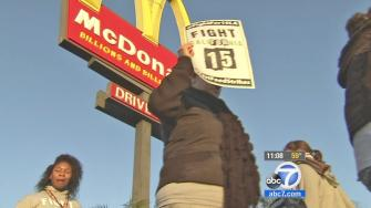 Fast food workers and supporters rallied outside restaurants, demanding a higher hourly wage on Thursday, Dec. 5, 2013.