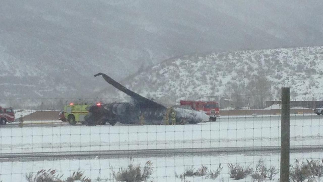 The wreckage of a plane crash is seen at Aspen Airport on Sunday, Jan. 5, 2014.