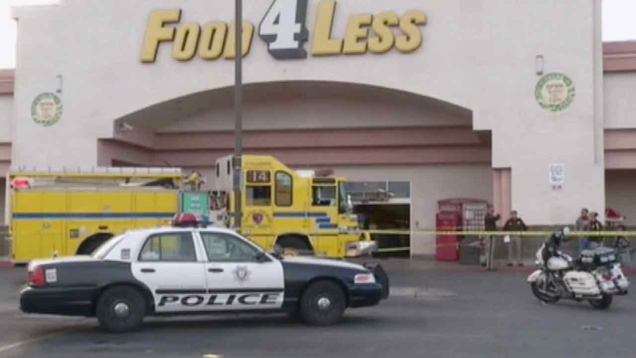 Las Vegas police respond to the scene of a crash at a Food 4 Less store located near Sahara and Eastern avenues Saturday, March 1, 2014.