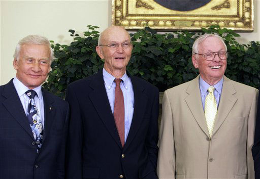 In this July 20, 2009, photo, Buzz Aldrin, left, Michael Collins, center, and Neil Armstrong stand in the Oval Office at the White House in Washington, on the 40th anniversary of the Apollo 11 moon landing. Neil Armstrong was a quiet self-described nerdy engineer who became a global hero when as a steely-nerved pilot he made &#34;one giant leap for mankind&#34; with a small step on to the moon. The modest man who had people on Earth entranced and awed from almost a quarter million miles away has died. He was 82.  <span class=meta>(AP Photo&#47; Alex Brandon)</span>