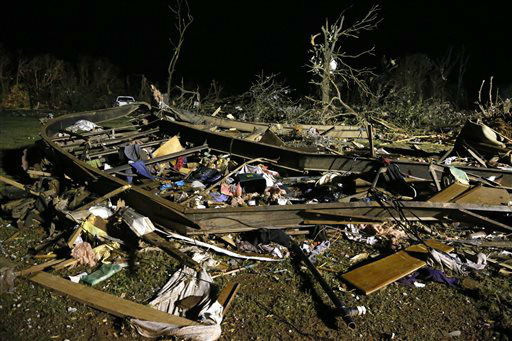 The frame of a mobile home is pictured with debris after a tornado hit a mobile home park near Dale, Okla., Sunday, May 19, 2013.