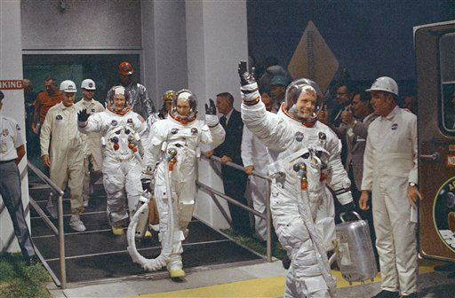 In this July 16, 1969 file photo, Neil Armstrong waving in front, heads for the van that will take the crew to the rocket for launch to the moon at Kennedy Space Center in Merritt Island, Florida.  The family of Neil Armstrong, the first man to walk on the moon, says he has died at age 82. A statement from the family says he died following complications resulting from cardiovascular procedures. It doesn&#39;t say where he died. Armstrong commanded the Apollo 11 spacecraft that landed on the moon July 20, 1969. He radioed back to Earth the historic news of &#34;one giant leap for mankind.&#34; Armstrong and fellow astronaut Edwin &#34;Buzz&#34; Aldrin spent nearly three hours walking on the moon, collecting samples, conducting experiments and taking photographs. In all, 12 Americans walked on the moon from 1969 to 1972.    <span class=meta>(AP Photo&#47; Uncredited)</span>