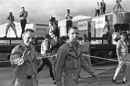 Astronauts Neil Armstrong, left, and David Scott say goodbye in Honolulu, March 19, 1966 as they walk to the plane that was to take them to Cape Kennedy, Fla., for 10 days of examinations and debriefings on the aborted flight of Gemini 7. The astronauts spent about 18 hours in Hawaii after flying in from Okinawa where a destroyer which had picked them out of the ocean landed them.   <span class=meta>(AP Photo&#47; Anonymous)</span>