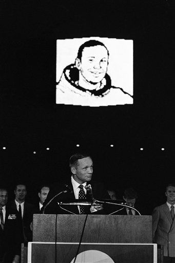 Apollo 11 Astronaut Neil Armstrong speaks to thousands who jammed the Astrodome in Houston, Tex., on August 16, 1969 to honor America?s moon explorers. In the background a giant likeness of the spaceflight commander is flashed on the fabulous Astrodome scoreboard.   <span class=meta>(AP Photo&#47; Anonymous)</span>