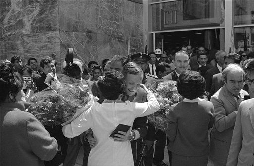 U.S. Apollo 11 astronaut Neil Armstrong, gets an embrace by unidentified woman who also presented him a bouquet of flowers. Neil and his two fellow moon travellers, Edwin Aldrin and Michael Collins arrived on Monday, Sept. 29, 1969 in Mexico City for a 22-hour visit.   <span class=meta>(AP Photo&#47; Anonymous)</span>