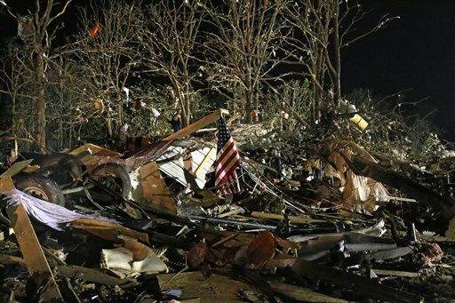 "<div class=""meta ""><span class=""caption-text "">A flag flies in the debris of a mobile home after a tornado struck a mobile home park near Dale, Okla., Sunday, May 19, 2013. (AP Photo/ Sue Ogrocki)</span></div>"