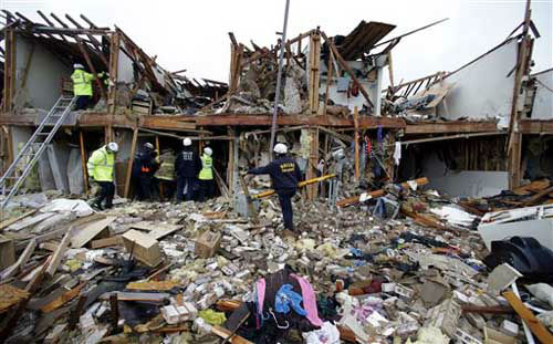 Firefighter conduct search and rescue of an apartment destroyed by an explosion at a fertilizer plant in West, Texas, Thursday, April 18, 2013.  A massive explosion at the West Fertilizer Co. killed as many as 15 people and injured more than 160, officials said overnight.    <span class=meta>(AP Photo &#47; LM Otero)</span>