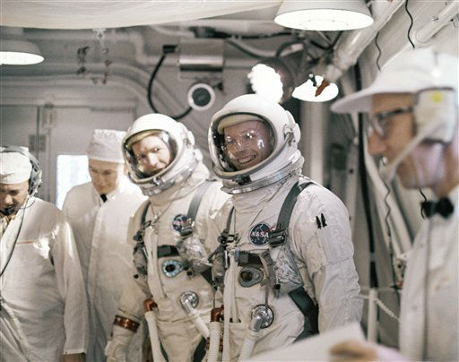 In this March 16, 1966 file photo Astronauts Neil A. Armstrong and David R. Scott arrive, March 16, 1966 at Complex 19 for a simulated test in preparation for flight. The family of Neil Armstrong, the first man to walk on the moon, says he has died at age 82. A statement from the family says he died following complications resulting from cardiovascular procedures. It doesn&#39;t say where he died. Armstrong commanded the Apollo 11 spacecraft that landed on the moon July 20, 1969. He radioed back to Earth the historic news of &#34;one giant leap for mankind.&#34; Armstrong and fellow astronaut Edwin &#34;Buzz&#34; Aldrin spent nearly three hours walking on the moon, collecting samples, conducting experiments and taking photographs. In all, 12 Americans walked on the moon from 1969 to 1972.    <span class=meta>(AP Photo&#47; Uncredited)</span>