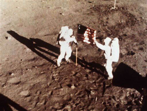 In this July 20, 1969 file photo provided by NASA shows Apollo 11 astronauts Neil Armstrong and Edwin E. &#34;Buzz&#34; Aldrin, the first men to land on the moon, plant the U.S. flag on the lunar surface. The family of Neil Armstrong, the first man to walk on the moon, says he has died at age 82. A statement from the family says he died following complications resulting from cardiovascular procedures. It doesn&#39;t say where he died. Armstrong commanded the Apollo 11 spacecraft that landed on the moon July 20, 1969. He radioed back to Earth the historic news of &#34;one giant leap for mankind.&#34; Armstrong and fellow astronaut Edwin &#34;Buzz&#34; Aldrin spent nearly three hours walking on the moon, collecting samples, conducting experiments and taking photographs. In all, 12 Americans walked on the moon from 1969 to 1972.    <span class=meta>(AP Photo&#47; Anonymous)</span>
