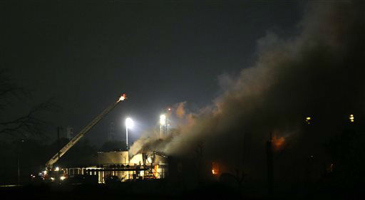 A fire smokes near a fertilizer plant that exploded earlier in West, Texas, in this photo made early Thursday morning, April 18, 2013.