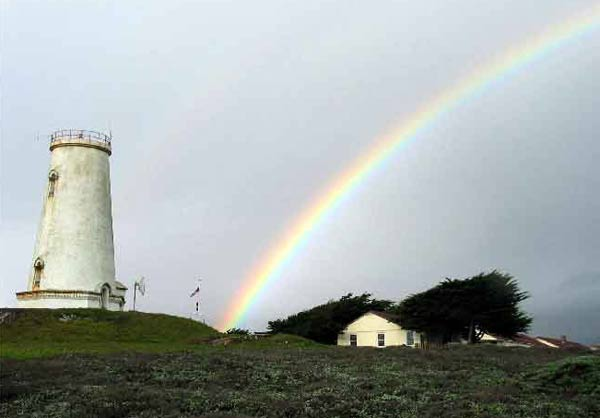 In this undated photo released by the Bureau of Land Management, a rainbow is seen near the Piedras Blancas lighthouse in San Simeon on California's Central Coast.