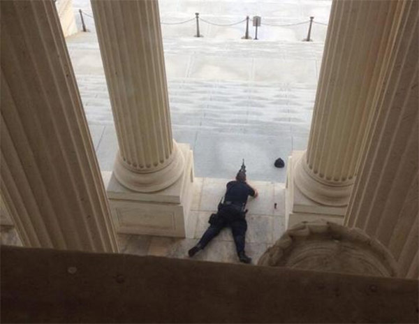 'Something happening outside Capitol. Police running around with guns at ready,' was the caption to this Oct. 3, 2013 photo posted to Twitter by Alex Leary.