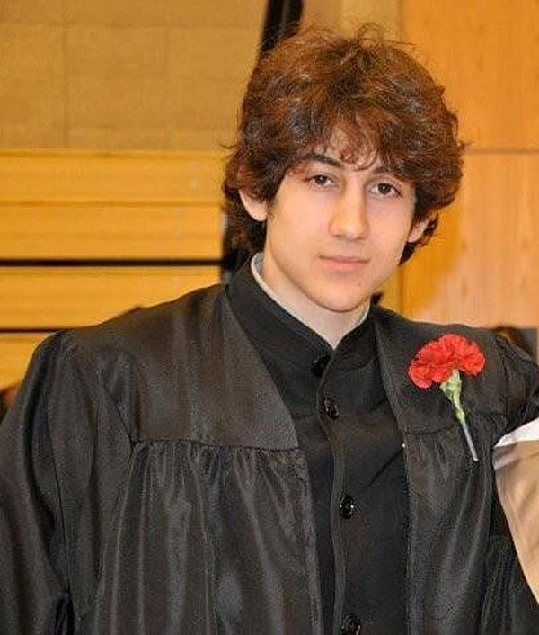 "<div class=""meta ""><span class=""caption-text "">In this undated photo provided by Robin Young, Dzhokhar A. Tsarnaev poses for a photo after graduating from Cambridge Rindge and Latin High School.  Tsarnaev has been identified as the surviving suspect in the marathon bombings. Two suspects in the Boston Marathon bombing killed an MIT police officer, injured a transit officer in a firefight and threw explosive devices at police during a getaway attempt in a long night of violence that left one of them dead and another still at large Friday, April 19, 2013. (Courtesy of Robin Young, Here and Now)</span></div>"