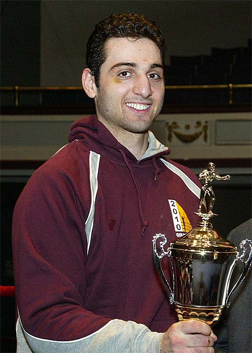 Tamerlan Tsarnaev, the Boston bombing suspect who was killed in a shootout with police overnight, is seen with a boxing trophy in this undated photo. <span class=meta>(Courtesy of The Sun of Lowell, Mass)</span>
