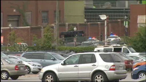 Authorities at the scene of a shooting at the Washington Navy Yard in Southeast Washington D.C. on Monday, Sept. 16, 2013.
