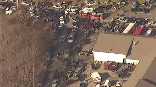 The scene outside Sandy Hook Elementary School in Newtown, Conn., following a mass shooting on Friday, Dec. 14, 2012.