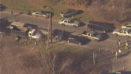 The scene outside Sandy Hook Elementary School in Newtown, Conn., following a mass shooting on Friday, Dec. 14, 2012. <span class=meta>(WABC &#47; Newscopter 7)</span>