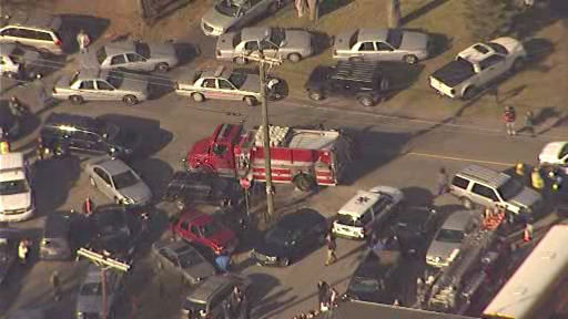 The scene outside Sandy Hook Elementary School in Newtown, Conn., following a mass shooting on Friday, Dec. 14, 2012. <span class=meta>(WABC-TV &#47; Newscopter 7)</span>