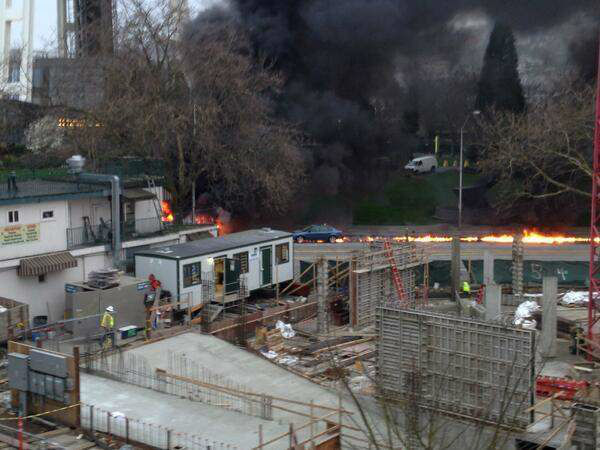 One of the first images, posted by a local radio presenter, from the scene after a KOMO-TV helicopter crashed into two cars near the Seattle Space Needle on Tuesday, March 18, 2014. Two people were killed and another critically injured, according to the Seattle Fire Department.  <span class=meta>(Alan Budwill&#47;@AlanOnSTAR)</span>
