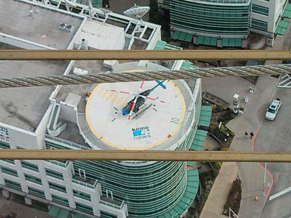 "<div class=""meta ""><span class=""caption-text "">ABC11-WTVD viewer JD Woodard sent in this photo he took of the KOMO-TV helicopter on its landing pad on April 3, 2013. The photo was taken from the top of the Space Needle. (WTVD/JD Woodard)</span></div>"
