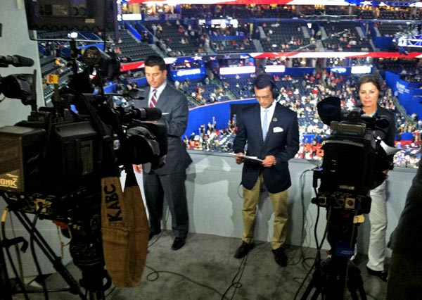 ABC7 Eyewitness News Anchor David Ono (center) prepares for a live report, along with other reporters from ABC affiliates, from the Republican National Convention in Tampa, Fla., on Tuesday, Aug. 28, 2012.