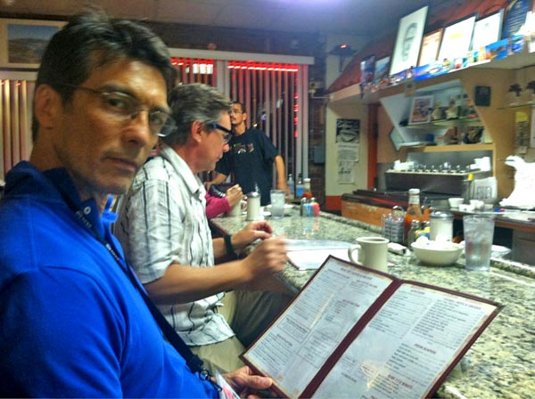 "<div class=""meta ""><span class=""caption-text "">ABC7 Eyewitness News' David Ono and crew grab a bite to eat at 3 a.m. at The Three Coins Diner in Tampa, Fla., after a day of covering the Republican National Convention in Tampa, Fla., on Monday, Aug. 27, 2012.</span></div>"