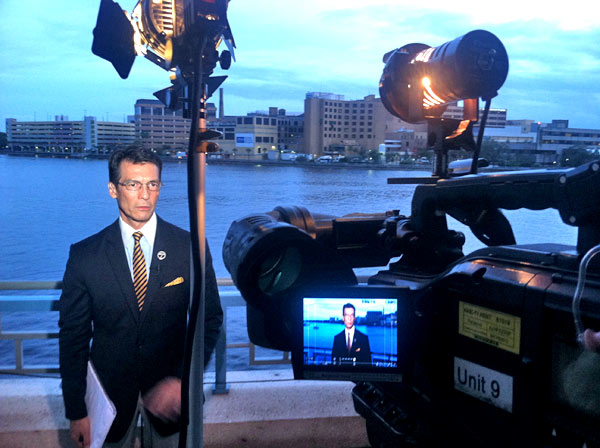 David Ono of ABC7 Eyewitness News prepares for a live shot from the Republican National Convention in Tampa, Fla., on Monday, Aug. 27, 2012.