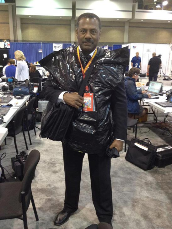 ABC7 Eyewitness News Anchor Marc Brown wears a trash bag over his clothing to the Democratic National Convention due to the weather in Charlotte, N.C., on Thursday, Sept. 6, 2012.